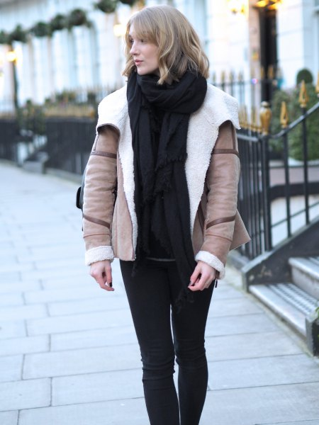 pink pink wing jacket with black sweater and knitted scarf