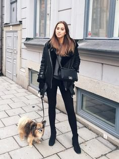 black flying jacket with gray chunky knit sweater and skinny jeans