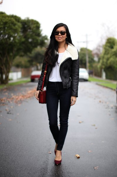 black flying jacket with white faur fur collar and skinny jeans