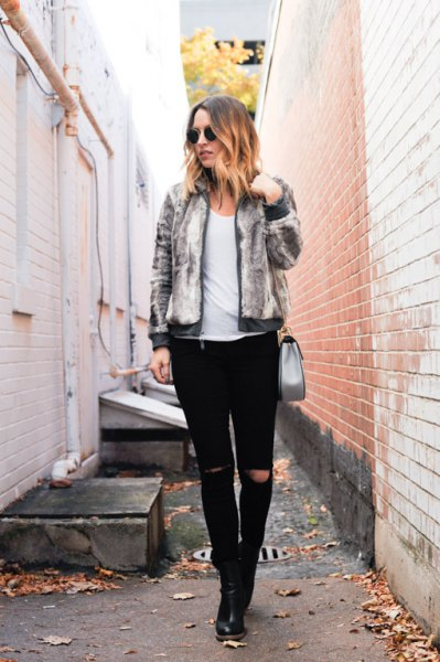 light gray fitted fur bomber jacket with black ripped slim fit jeans