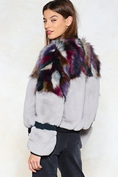 white and black printed fur jacket with navy blue pants