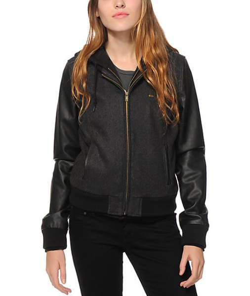 black fleece and leather two toned hood bomber jacket with skinny jeans