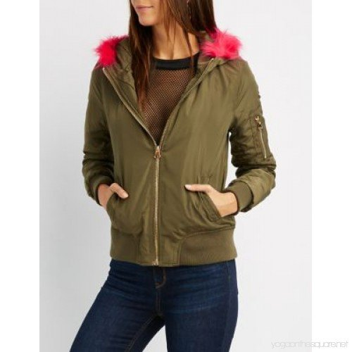 green bomber jacket with net blouse and jeans