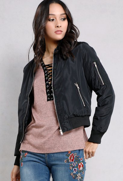 black fitted jacket with gray lace tee and embroidered jeans
