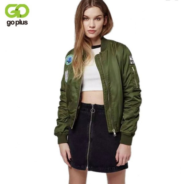 embroidered olive bomber jacket with white crop top and black high-rise