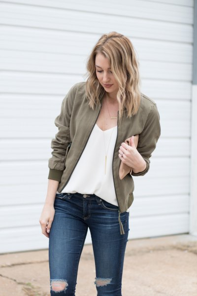 deep v-neck chiffon blouse with olive jacket and ripped jeans