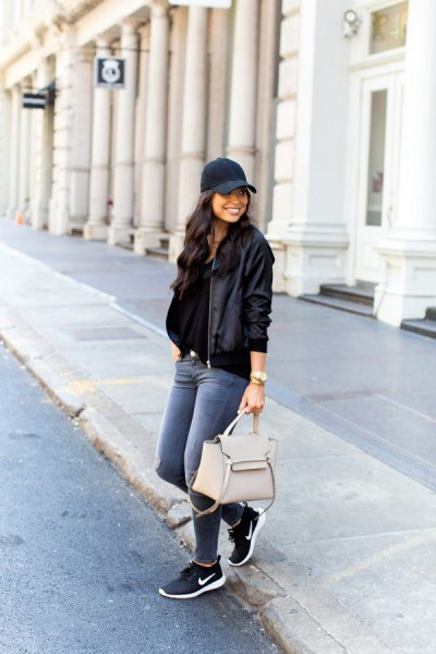 navy blue baseball cap with black flying jacket and sneakers