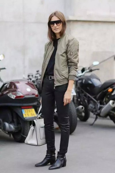 light gray flying jacket with black leather legs