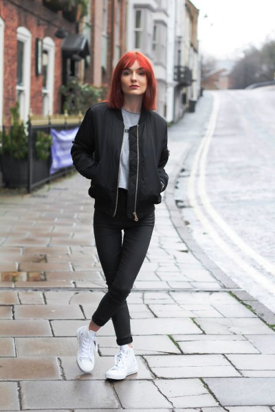 black jacket with matching slim jeans and white sneakers