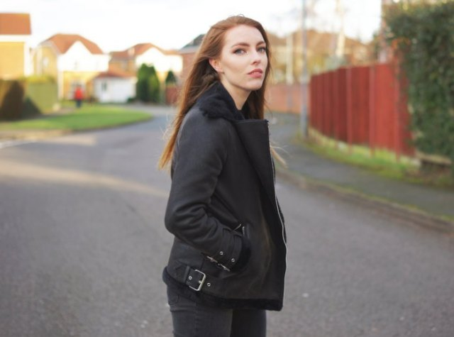 black flying jacket with matching slim fit jeans and boots