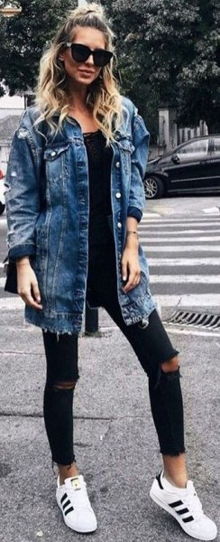 blue boyfriend clothing jacket with black lace neck and ripped jeans