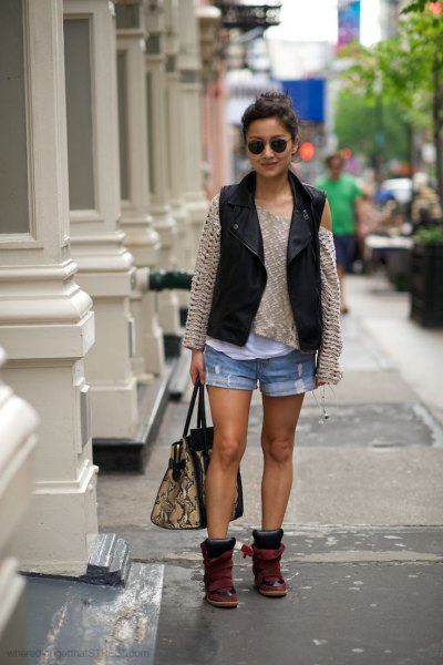 black moto-vest with pink pink sweater and mini-shorts in denim