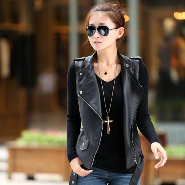 long pull out necklace with black long sleeve fitted tee and leather vest