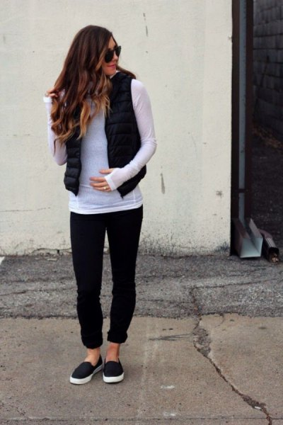gray long sleeve t-shirt with black puffer vest and cuffed jeans