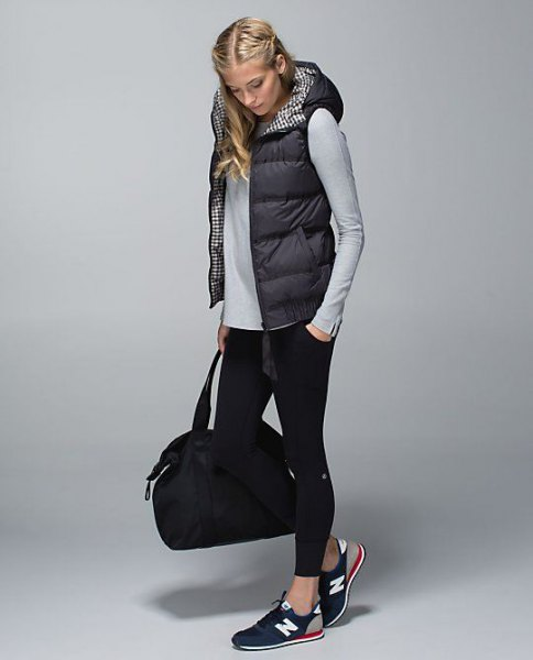 black hooded puffer vest with gray fitted long sleeve tee and cropped skinny jeans