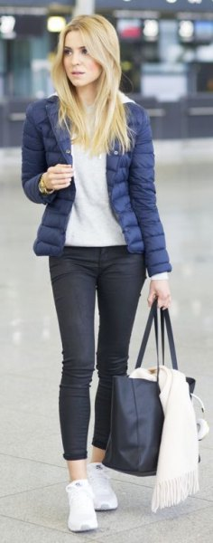 purple down jacket with light gray hoodie and black jeans