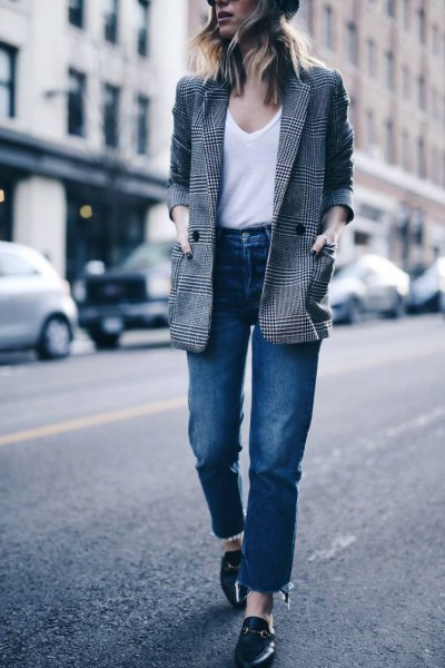 gray plaid jacket with white top with shoe neck and jeans with high waist