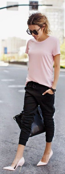 light pink t-shirt with black cropped joggers and white high heels