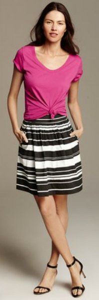 pink buttoned buttoned tee with black and white striped knee length skirt