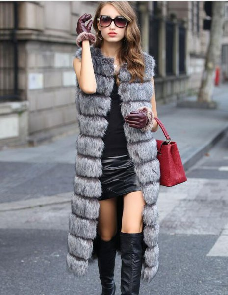 gray quilted faux fur long vest with black mini leather skirt