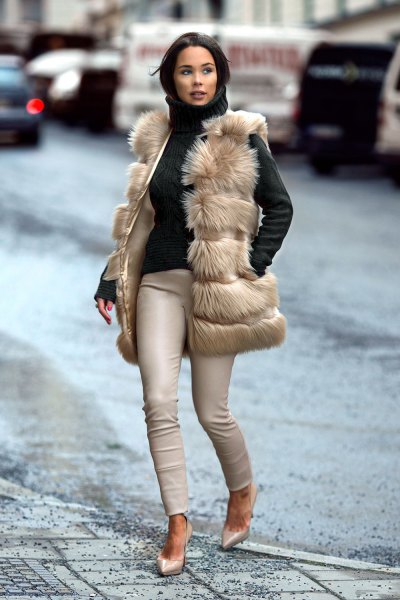 light brown vest with black turtleneck matching sweater