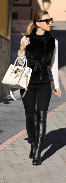 white long sleeve tee with black button up fur vest and leather shoes