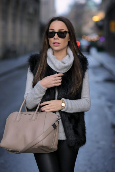 gray sweater neck shirt with black fur vest and leather pants