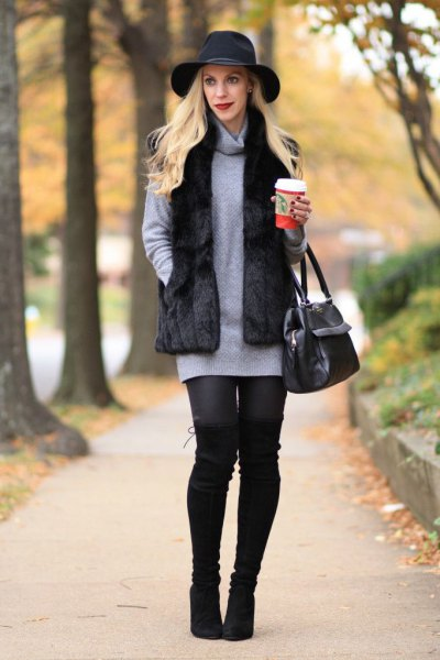 black floppy hat with gray sweater in knee-neck and leggings