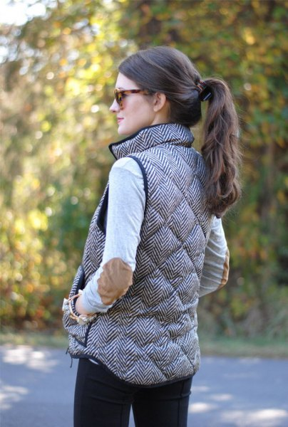 gray quilted long down vest with patch elbow white top