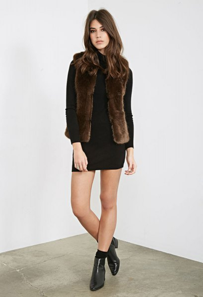 black long-sleeved mini-shift dress with dark brown faux fur vest