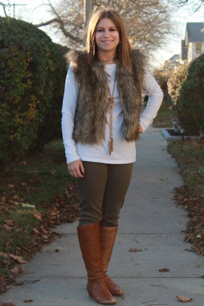fur vest with white long-sleeved tee and brown shoes in knee-high shoes