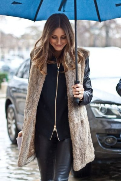 long light brown vest with black motorcycle jacket and leather clothes