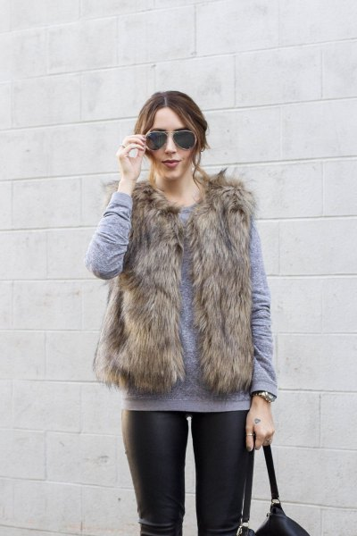 gray crew neck sweater with brown fur coat