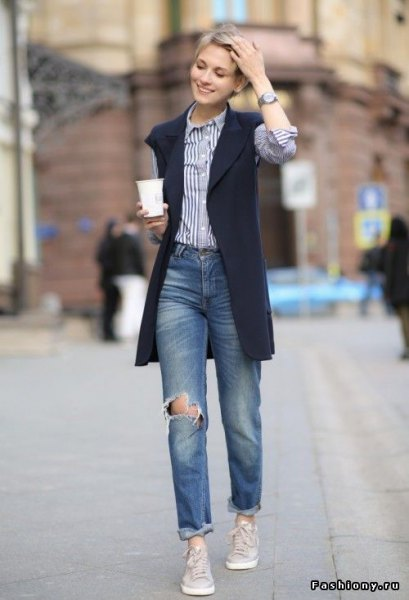 black vest jacket with blue and white vertical striped shirt and boyfriend jeans