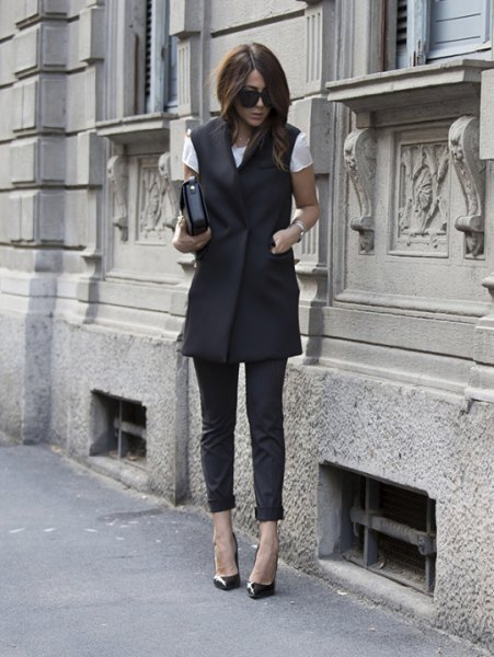 black long-sleeved jacket with white fitted tee and cropped leather trunks