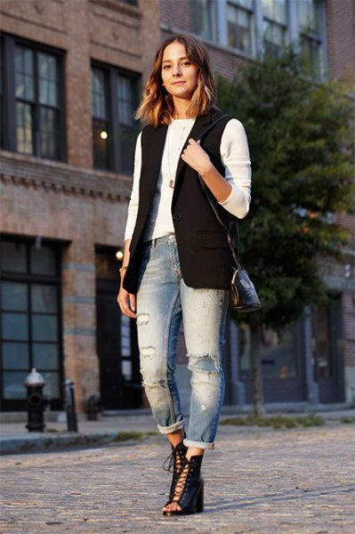 black sleeveless jacket with white long sleeve tee and cuffed boyfriend jeans