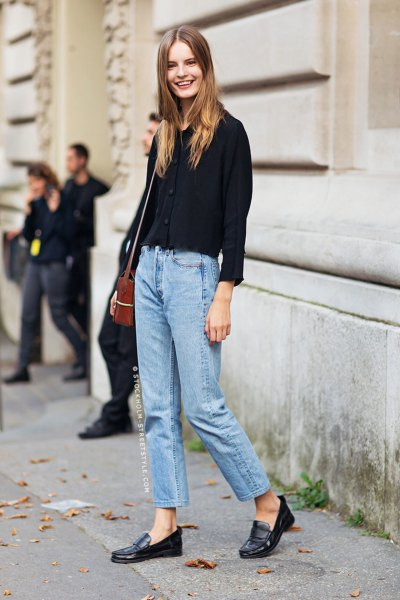 black chunky sweater with mom jeans and penny loafers