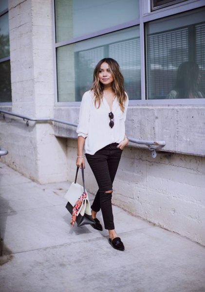white half-heated casual blouse with black ripped slim fit jeans and loafers