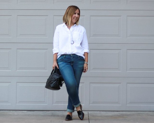 white button-up shirt with cuffed slim fit jeans and black loafers