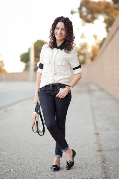 white button up shirt with black collar and dark cuffed skinny jeans