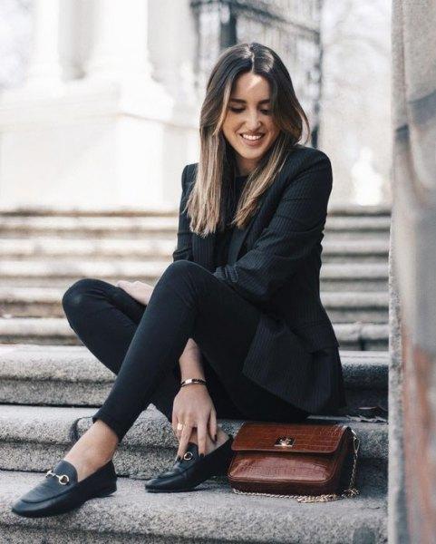 black blazer with slim fit jeans and jewelry