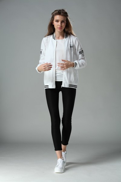 bomber jacket with black crop leggings and white sneakers