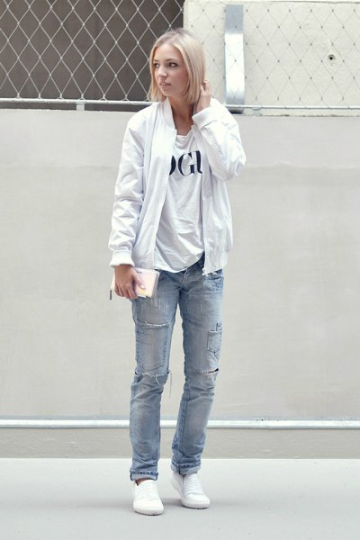 pure white bomber jacket with print shirt and blue jeans with straight legs