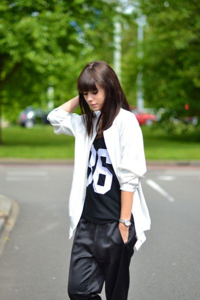 white big jacket with black tee and baggy pants