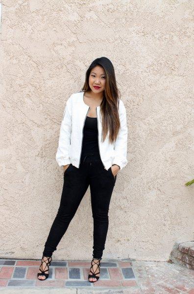 black shoulder strap and slim fit jeans