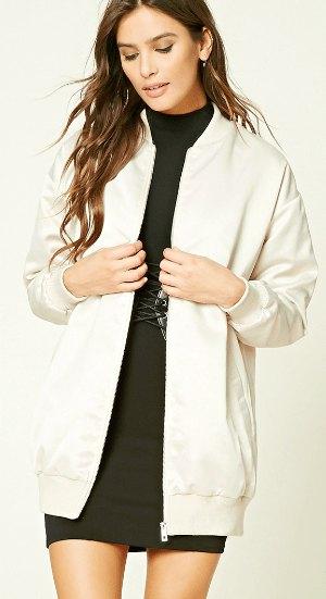 long white white bomber jacket with black shift dress in black mock