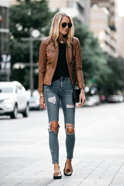 brown leather jacket with gray ripped skinny jeans and tan loafers