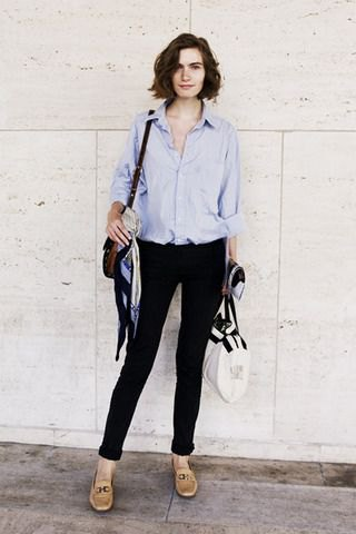 light blue button up shirt with high rising black skinny jeans and leather skins