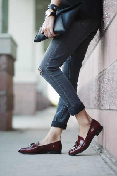 black blazer with gray cuffed skinny ripped jeans and burgundy loaf