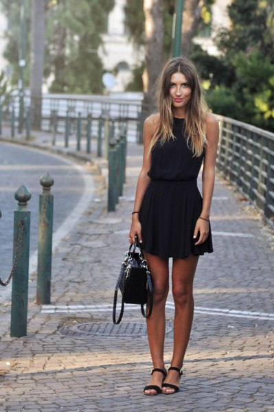 black fit and flare sleeveless mini dress with open toe heels and leather bag
